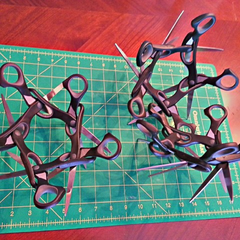 Scissaurus Icosa Begins with five scissors assembly.